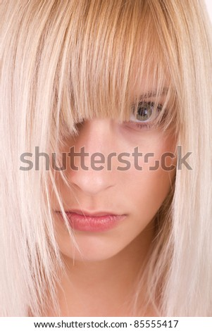 Woman with beautiful long blond hairs - stock photo
