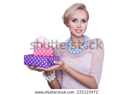 Woman with beautiful smile holding colorful gift boxes. Christmas. Holiday. Studio portrait isolated over white background - stock photo