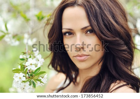 Woman with beauty long brown hair - outdoors - stock photo