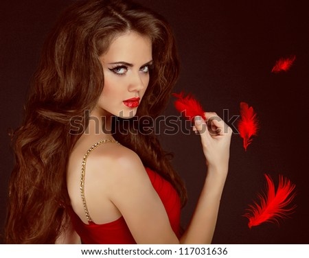 Woman with beauty long curly brown hair and red lips. Fashion woman Portrait. - stock photo
