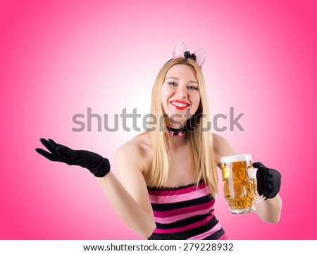 Woman with beer isolated on white - stock photo