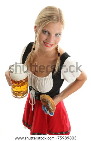 Woman with beer mug and pretzel