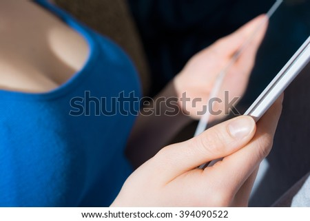 Woman With Big Breasts Holding A Blank Business Tablet Computer In Her Hands
