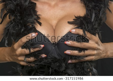 Woman with Big Breasts In Sexy Corset Underwear and black feather