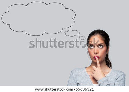 Woman with big brown eyes looking upwards thinking with blank thought bubbles above her head, isolated on white background.