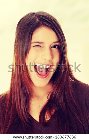 Woman with big smile blinking.
