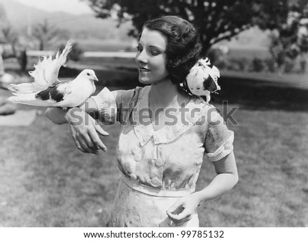 Woman with birds - stock photo