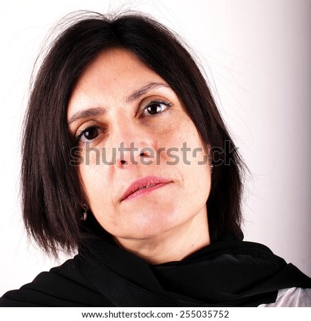 Woman with black transparent scarf - stock photo