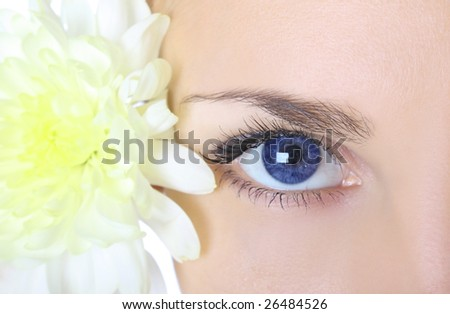 woman with blue eyes and flower