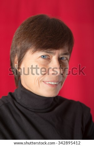 woman with blue eyes on a red background