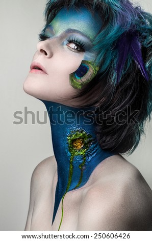Woman with Blue Painted Skin - stock photo