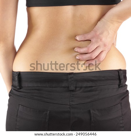 Woman with both palm around back to show pain and injury on back area. Medical health care concept. - stock photo