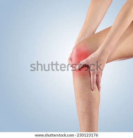 Woman with both palm around knee cap to show pain and injury on knee area. - stock photo