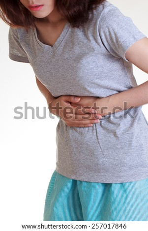 Woman with both palm around waistline to show pain and injury on belly area and stomach ache. Medical health care concept. - stock photo