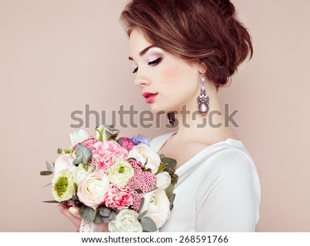 Woman with bouquet of flowers in her hands. Flowers. Spring. Bride. March 8. Fashion photo - stock photo