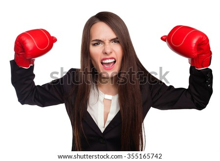 Woman with boxing gloves and strict office clothes