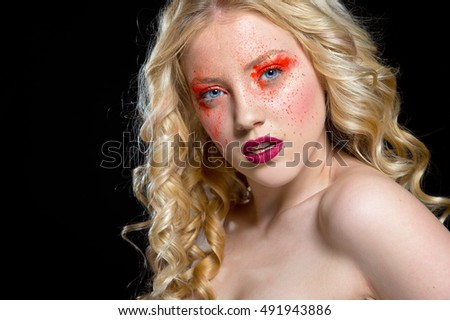 Woman with bright make up. Bright make up with pigment eye shadows. Halloween
