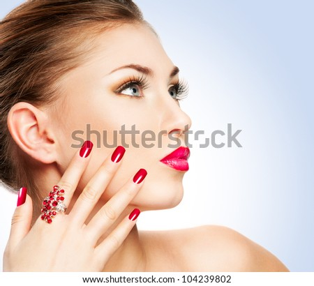 Woman with bright red lips and manicure - stock photo