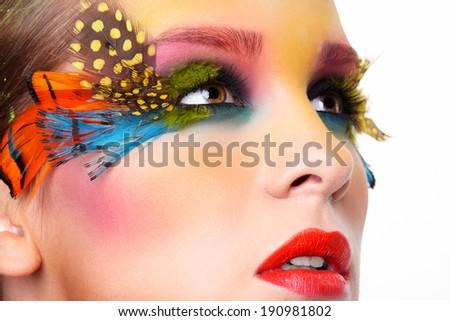 Woman with bright stylish make-up and false fashion feather eyelashes  - stock photo