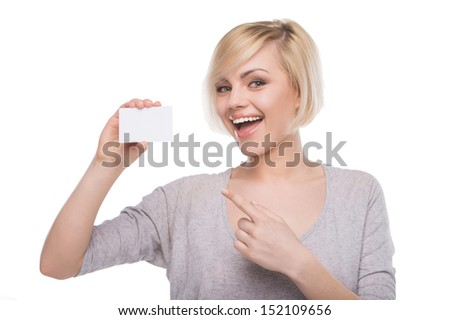 Woman with business card. Beautiful young blond hair woman holding business card and smiling while isolated on white - stock photo
