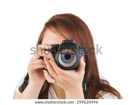 Woman with camera and eye in lens isolated on white background - stock photo