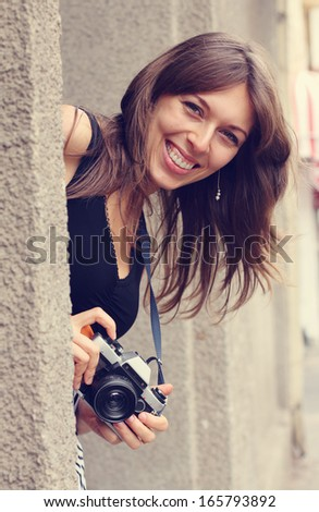 woman with camera outdoors - stock photo