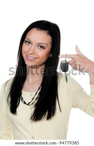 woman with car keys after driving test - stock photo