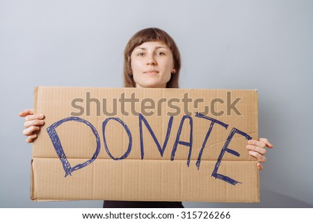 Woman with cardboard sign, donation. On a gray background.