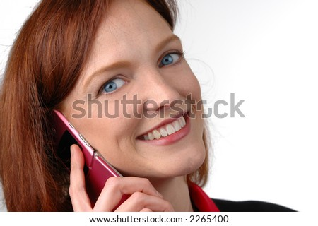 Woman with cell phone on a suit and against a white background