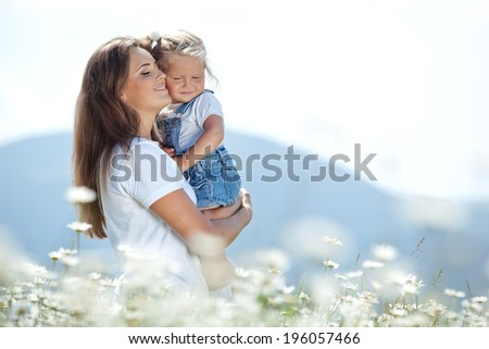 Woman with child in nature