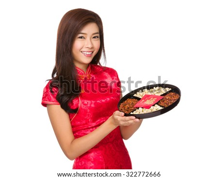 Woman with chinese gown hold with snack tray