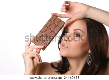 woman with chocolate on white - stock photo