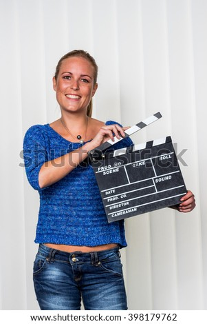 woman with clapperboard - stock photo