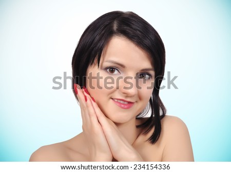 woman with clean skin on a blue background - stock photo