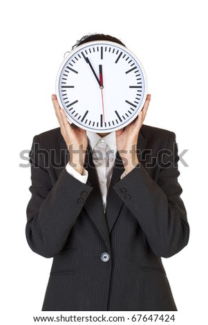 Woman with clock in front of face express stress by time pressure. Isolated on white background.