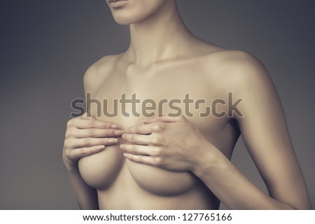 woman with closed breasts - stock photo