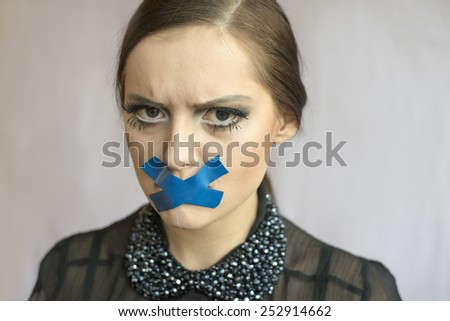 woman with closed mouth - stock photo