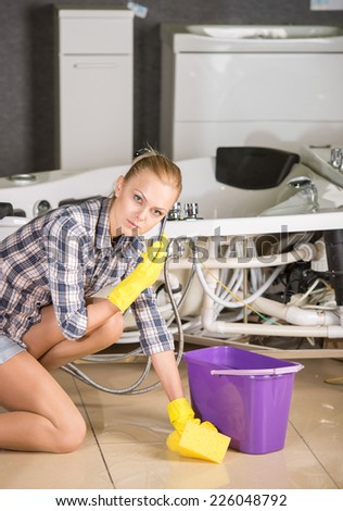 Woman with cloth is cleaning the floor. - stock photo