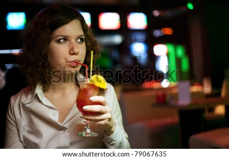 woman with  cocktail in bar - stock photo