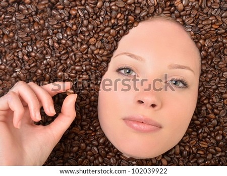 woman with coffee beans background - stock photo