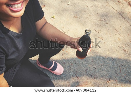 Woman with cola drink bottle - stock photo
