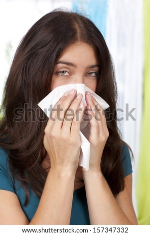 Woman with cold and handkerchief