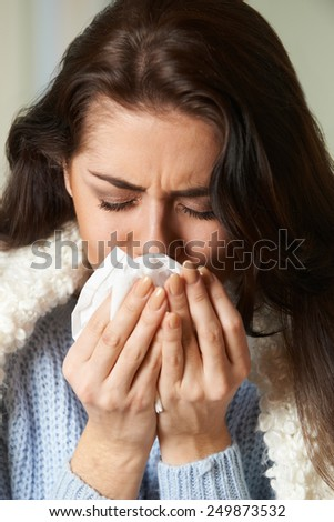 Woman With Cold Holding Tissue And Sneezing - stock photo