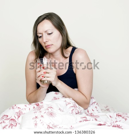 woman with colds tea in bed