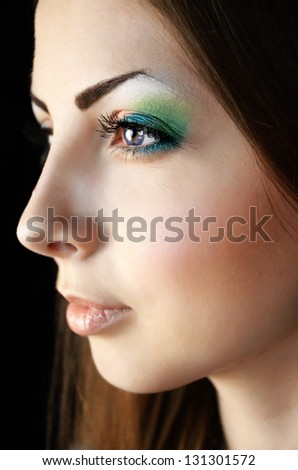 Woman with color makeup - stock photo
