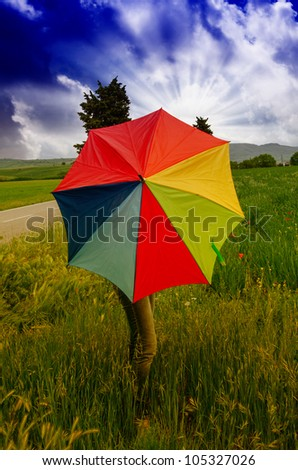 Woman with colorful Umbrella in Tuscany Spring Countryside