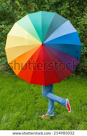 Woman with colorful umbrella outdoors - stock photo