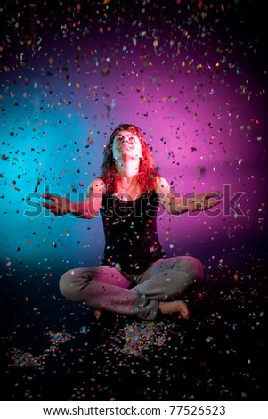 Woman with confetti on pink-blue background - stock photo