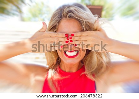 Woman with covered eyes - stock photo