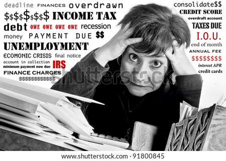 Woman with crazed expression working on income tax return and household finances, while surrounded by text of her worries - stock photo